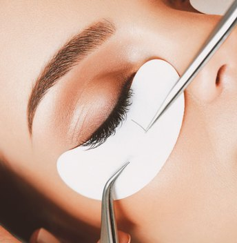 Woman getting a natural-looking beauty revamp with best eyelash extensions